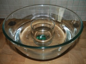 Malachite in glass stood in bowl of water